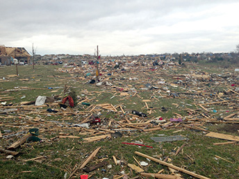 """Tornado debris was scattered throughout the area. Browning said, """"If the storm had tracked just 200 yards further southeast, it would have taken not only our building, it would have hit a Christian nursing home, our community center—where another church meets—and two more church buildings just beyond ours."""""""
