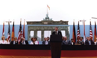 "President Ronald Reagan calls for Soviet leader Mikhail Gorbachev to ""tear down this wall"" during a speech at the barrier dividing East Berlin from West Berlin on June 12, 1987. (White House Photographic Office/Ronald Reagan Presidential Library/courtesy of Wikimedia Commons)"